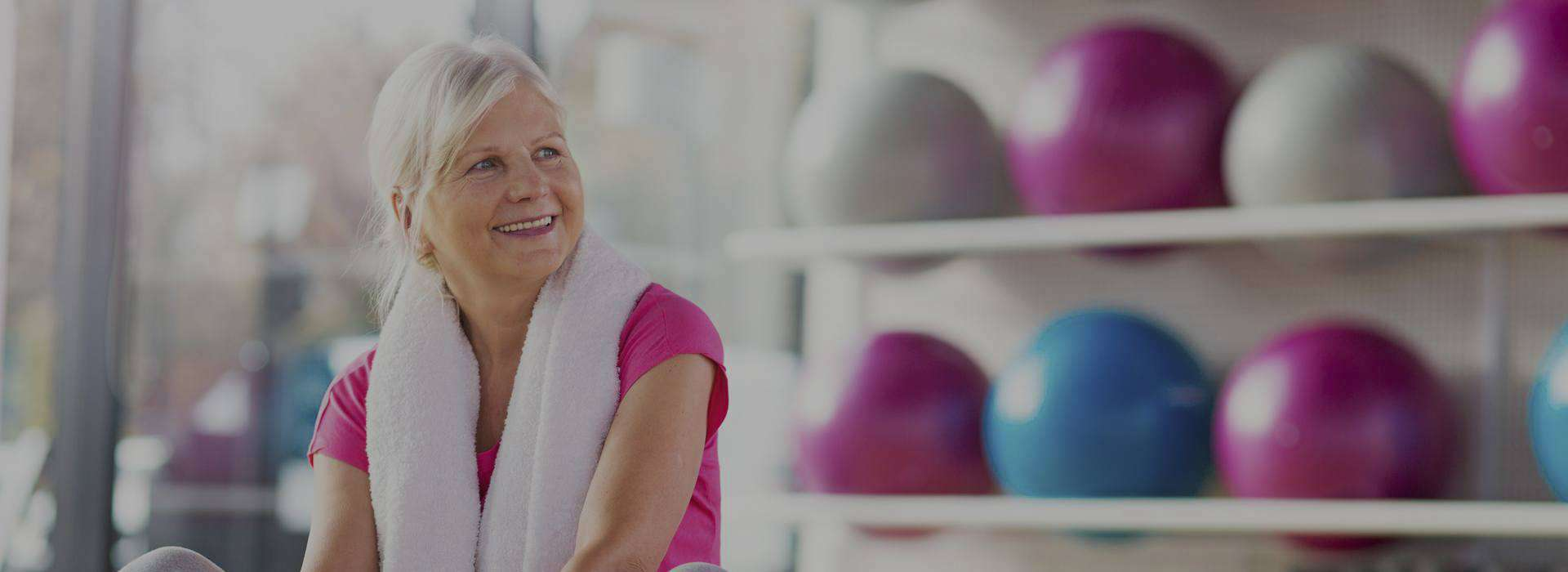 Elderly woman smiling after exercising at Green Apple Wellness Centre